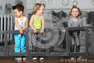 Little boys and girl together carry wooden stairs