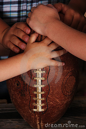 Little Boys Hands on Football