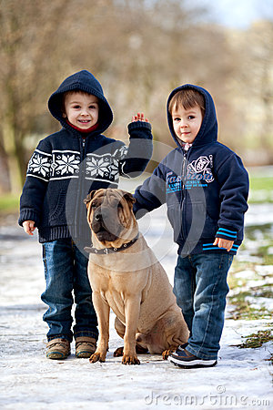 Free Little Boys In The Park With Their Dog Friend Royalty Free Stock Photos - 37562028