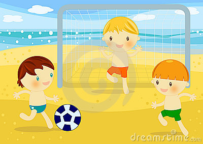 Little boys playing football on the beach