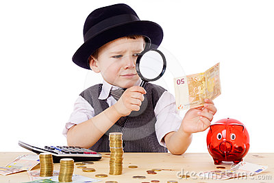 Little businessman checks the money