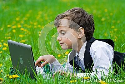 Little businessman outdoors
