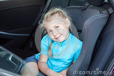 Little Caucasian Blond Girl In Car Safety Seat Royalty