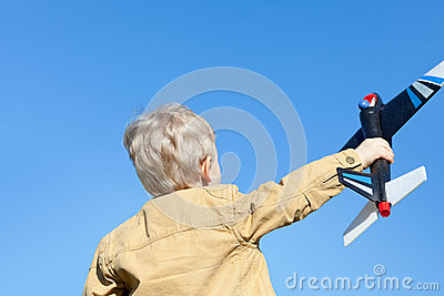 Boy holding a plane