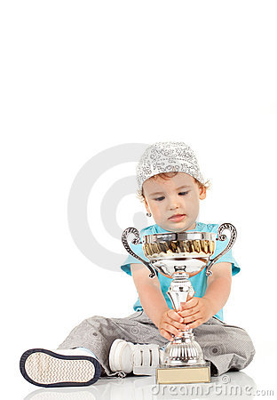 Little champion with his trophy