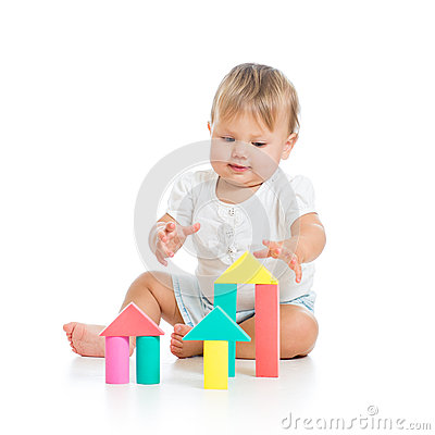 Little cheerful baby playing with construction set