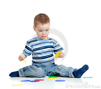 Little child assembling construction set