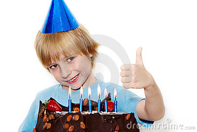 Little child with cap and cake