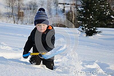 Little child in deep snow