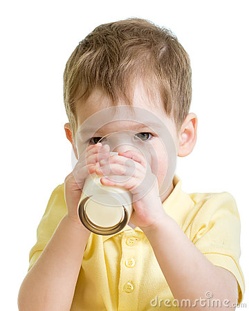 Little child drinking milk or kefir isolated