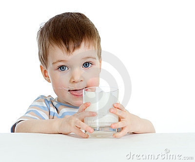 Little child drinking yogurt or kefir over white