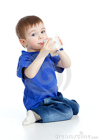 Little child drinking yogurt over white