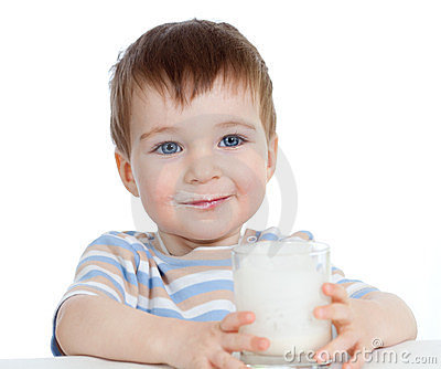 Little child drinking yogurt over white