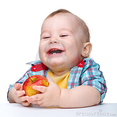 Little child is eating red apple and smile