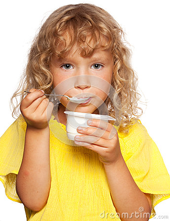 Little child eating yogurt