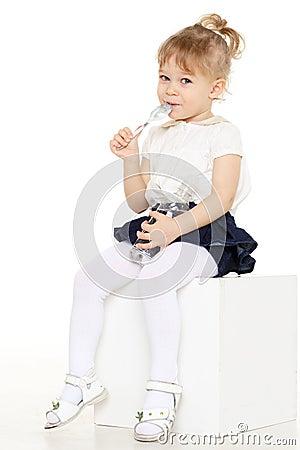 Little child eats yogurt