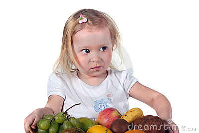 Little child with fruits