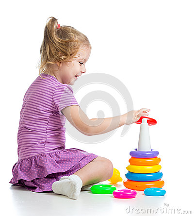 Little child girl playing with colorful toys