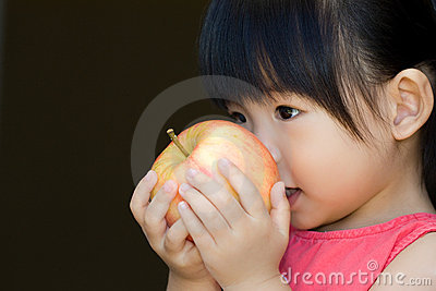 A little child hold a red apple