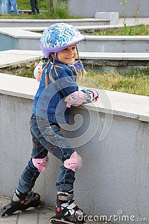 little  child on inline skates  with helmet