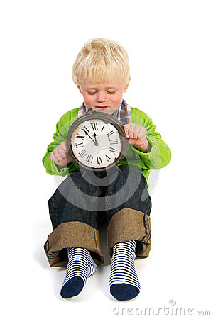 Little child with old clock