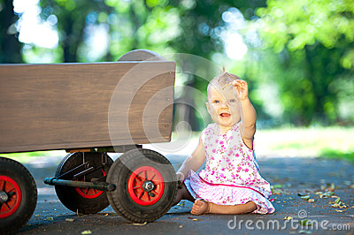 Little child and old wagon trolley