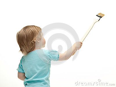 Little child painting white wall