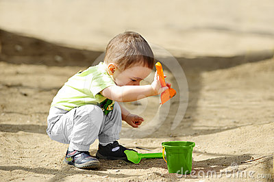 Little child playing in sandbox