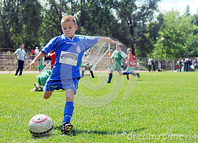 Little child plays football or soccer Editorial Stock Photo