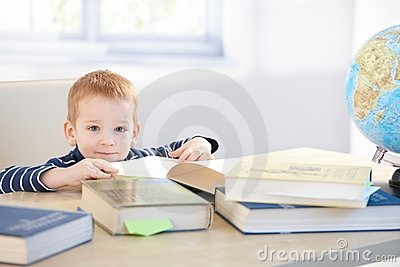 Little child prodigy learning at home smiling