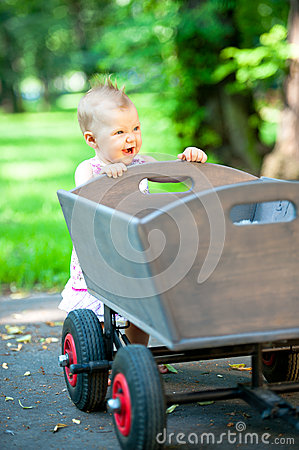 Little child push old wagon trolley