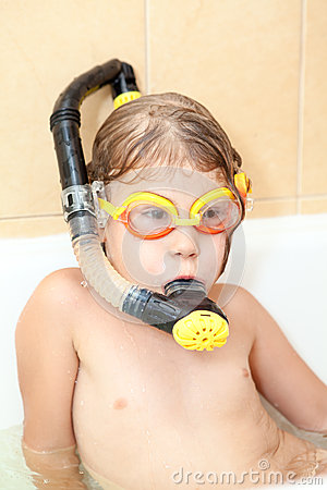 Little child with snorkel and mask