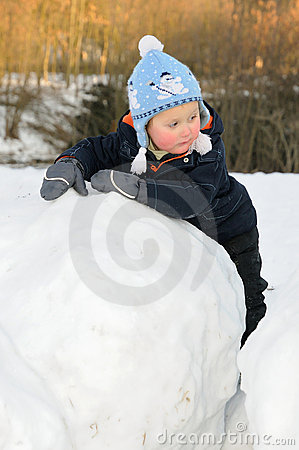 Little child on snowball