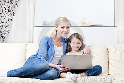 Little child surfs on the internet