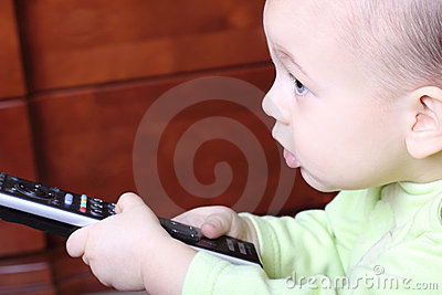 Little child with a TV remote control
