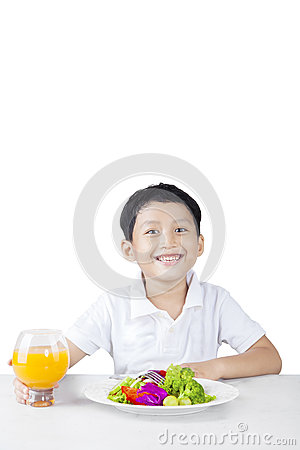 Free Little Child With His Salad And Orange Juice Royalty Free Stock Photos - 64476038