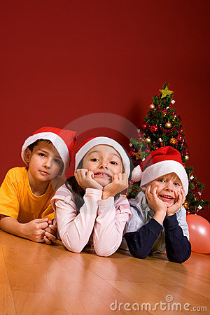 Little children as Santa in red cap