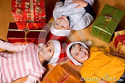 Little children as Santa in red cap