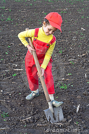 Little children with big shovel Stock Photo