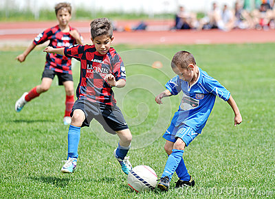 Little children boys play football or soccer Editorial Photography