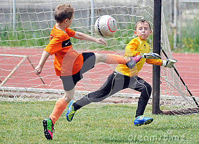 Little children boys play football or soccer Editorial Stock Image