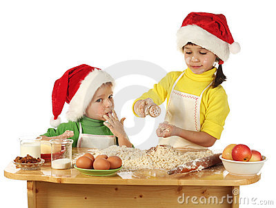 Little children cooking the Christmas cake