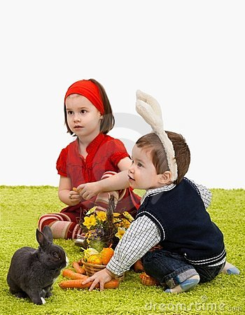 Little children playing with Easter bunny