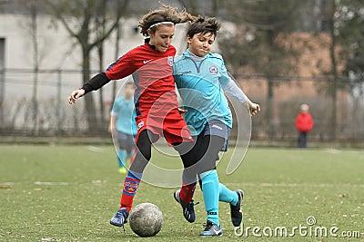 Little children playing football or soccer