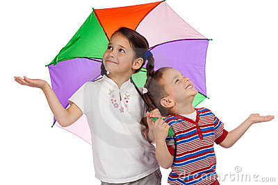 Little children with umbrella, checking for rain