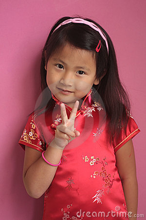 Little chinese girl with red dress