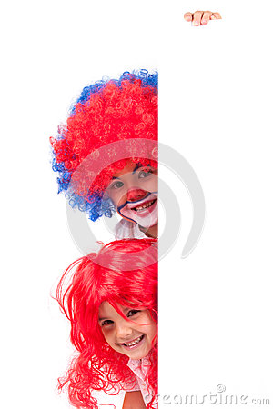Little clown boy and little girl with a red wig