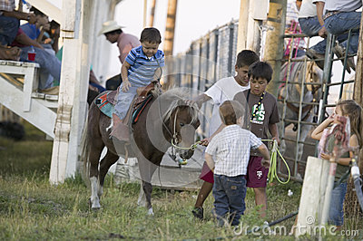 Little cowboys riding pony Editorial Photography