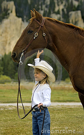 Free Little Cowgirl And Her Horse Royalty Free Stock Photo - 417915