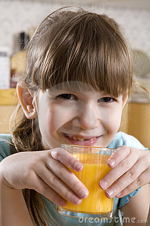 Little cute adorable  girl  drink orange juice